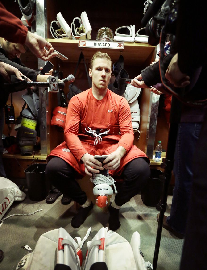 Detroit Red Wings goalie Jimmy Howard addresses the media after participating in the team photo at Joe Louis Arena in Detroit, Tuesday, April 29, 2014. The Red Wings were eliminated by the Boston Bruins in the first round of the Stanley Cup hockey playoffs. (AP Photo/Carlos Osorio)