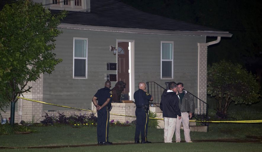 Members of the Tuscaloosa Police Department stand outside of the home where Alabama student John Servati died after taking refuge from a storm on Monday,  April 28, 2014. Servati, who was from Tupelo, Miss., was a member of the Alabama swim team. (AP Photo/The Tuscaloosa News, Robert Sutton)