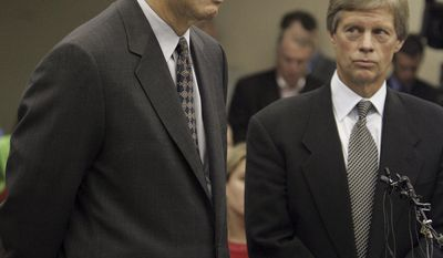 FILE-This Thursday, Aug. 18, 2005 file photo shows Ohio Gov. Bob Taft, left, addressing the court as his attorney, William Meeks, right, looks on in Columbus, Ohio. Legal records of the historic conviction of Taft in a 2005 rare-coin investment scandal have been shielded forever from public view. Taft, descendant of a U.S. president, is Ohio's only governor convicted of a crime.  (AP Photo, File)