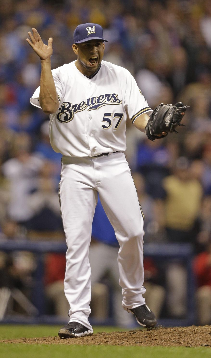 Milwaukee Brewers' Francisco Rodriguez reacts after getting the last out against the Chicago Cubs during the ninth inning of a baseball game on Saturday, April 26, 2014, in Milwaukee. The Brewers won 5-3. (AP Photo/Jeffrey Phelps)