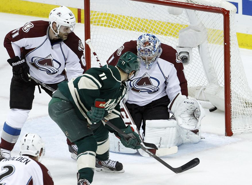 A shot by Minnesota Wild center Mikael Granlund gets past Colorado Avalanche goalie Semyon Varlamov, right, of Russia, as Minnesota Wild left wing Zach Parise (11) and  Avalanche defenseman Andre Benoit (61) watch the goal during the first period of Game 6 of an NHL hockey first-round playoff series in St. Paul, Minn., Monday, April 28, 2014. (AP Photo/Ann Heisenfelt)