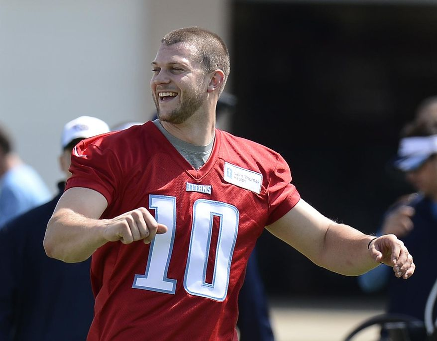 Tennessee Titans quarterback Jake Locker warms up during an NFL football minicamp workout on Tuesday, April 29, 2014, in Nashville, Tenn. (AP Photo/Mark Zaleski)
