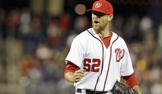 Washington Nationals relief pitcher Ryan Mattheus (52) celebrates after the last out of the eighth inning of a baseball game against the Atlanta Braves at Nationals Park, Wednesday, Sept. 18, 2013, in Washington. The Braves won 5-2. (AP Photo/Alex Brandon)