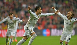 Real's Cristiano Ronaldo celebrates after scoring his side's 4rd goal during the Champions League semifinal second leg soccer match between Bayern Munich and Real Madrid at the Allianz Arena in Munich, southern Germany, Tuesday, April 29, 2014. (AP Photo/Kerstin Joensson)