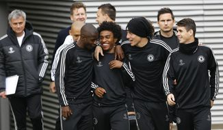 Chelsea's players Ramires, left, Willian, second left, David Luiz, second right, and Eden Hazard, right, arrive for a training session at Cobham in England Tuesday, April 29, 2014. Chelsea will play in a Champions League semifinal second leg soccer match against Atletico Madrid on Wednesday. (AP Photo/Kirsty Wigglesworth)