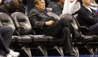 Donald Sterling sits courtside at a 2010 game. The Los Angeles Clippers owner has been banned for life by the  NBA, in response to racist comments the league says he made in a recorded conversation. (AP Photo/Danny Moloshok, File)
