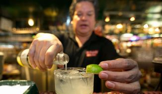 In this Monday, April 28, 2014, file photo, bartender Mario Sanchez crafts a margarita cocktail at the bar of El Coyote, a Mexican restaurant in Los Angeles. (AP Photo) ** FILE **