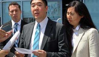 FILE - In this Thursday, March 27, 2014, file photo, Matthew, left, and Grace Huang, an American couple charged with starving to death their 8-year-old adopted daughter, speak to the press outside a courthouse before their trial in Doha, Qatar. A lawyer for an American couple sentenced to jail in Qatar over charges they starved their 8-year-old adopted daughter to death said Tuesday, April 29, 2014, their defense team will keep pursuing efforts to allow the family to leave the Gulf nation while their case is appealed. (AP Photo/Osama Faisal, File)