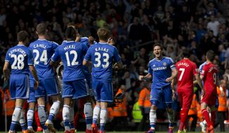 Chelsea's Frank Lampard, centre right, celebrates with teammates as his team beat Liverpool 2-0 in their English Premier League soccer match against Liverpool at Anfield Stadium, Liverpool, England, Sunday April 27, 2014. (AP Photo/Jon Super)