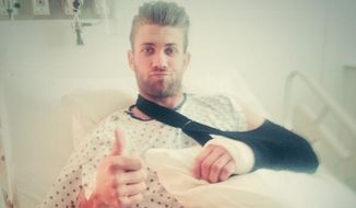 "Bryce Harper of the Washington Nationals posted this photo to his Twitter account Tuesday, April 29, 2014 after undergoing surgery on his left thumb. He wrote: ""On the road to recovery..Everything went great and I'll be back soon! Thank you to all the fans for the support!"" (via Twitter)"