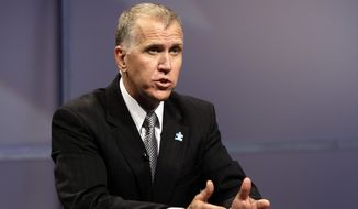 ** FILE ** In this April 23, 2014, photo, Republican senatorial candidate Thom Tillis responds during a televised debate at WRAL television studios in Raleigh, N.C. (AP Photo/Gerry Broome, Pool)