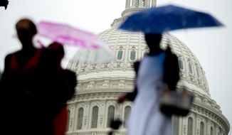 ** FILE ** Rain falls on Capitol Hill, Washington, D.C., Tuesday, April 29, 2014. (Andrew Harnik/The Washington Times)