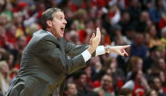 Washington Wizards head coach Randy Wittman gestures to an official during the second half of Game 5 in an opening-round NBA basketball playoff series against the Chicago Bulls, Tuesday, April 29, 2014, in Chicago. The Wizards won 75-69. (AP Photo/Charles Rex Arbogast)