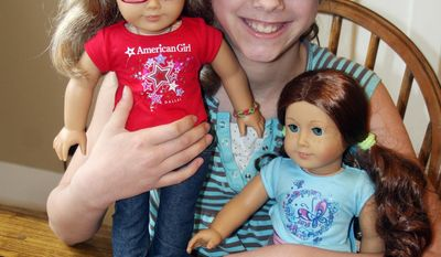 ADVANCED FOR RELEASE MONDAY, MAY 5, 2014 Anja Busse of Antigo cuddles her two American Girl dolls. Busse, who was diagnosed with Type 1 Diabetes in October, has started an online petition drive to persuade the popular toy manufacturer to offer dolls with diabetic supplies. (AP Photo/Antigo Daily Journal, Lisa Haefs)
