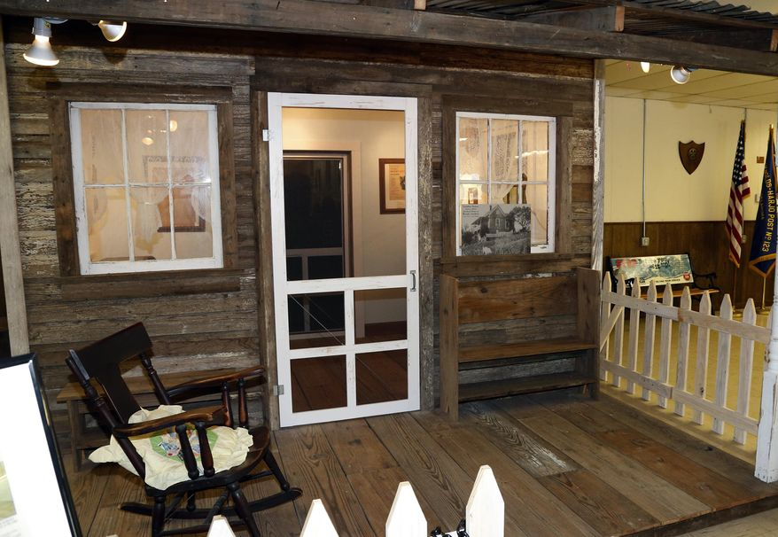FILE - This Aug. 22, 2013 file photo shows a replica of sorts fashioned from wood from folk singing legend Woody Guthrie's childhood home at the Okfuskee County History Center in Okemah, Okla. Famous guitar maker Gibson plans to auction off eight custom-made guitars built using original wood from Guthrie's 1860s-era boyhood home, on eBay beginning Thursday May 1, 2014 to raise money for THE $600,000 project. (AP Photo/Sue Ogrocki, File)