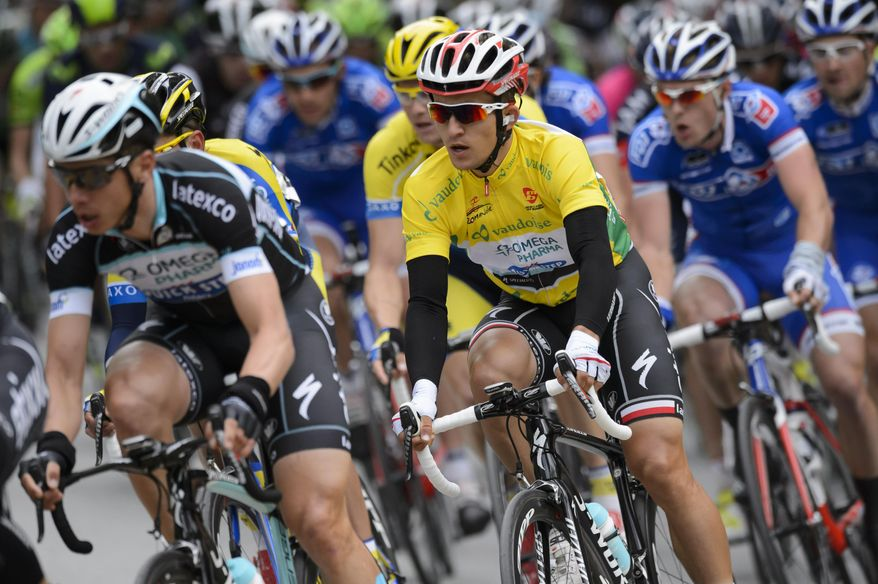 Overall leader Polish Michal Kwiatkowski, right, of team Omega Pharma-Quick Step competes during the first stage, a 88,5 km race from Brigerbad to Sion, at the 68th Tour de Romandie UCI ProTour cycling race in Sion, Switzerland, Wednesday, April 30, 2014. (AP Photo/Keystone, Laurent Gillieron)