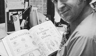 "FILE - In this 1972 file photo, ""Mad"" magazine editor Al Feldstein works on page layout in his office at the magazine's New York headquarters. Feldstein, whose 28 years at the helm of Mad transformed the satirical magazine into a pop culture institution, died Tuesday, April 29, 2014. He was 88. (AP Photo/Jerry Mosey, File)"