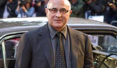 """FILE - This Sept. 20, 2010 file photo shows British actor Bob Hoskins arriving for the World Premiere of """"Made in Dagenham"""" in London. Bob Hoskins, whose varied career ranged from """"Mona Lisa"""" to """"Who Framed Roger Rabbit?"""" has died aged 71. A family statement released Wednesday by agent Clair Dobbs said Hoskins died in a hospital after a bout of pneumonia. In 2012 Hoskins announced that he had been diagnosed with Parkinson's disease and was retiring from acting. (AP Photo/Joel Ryan, file)"""