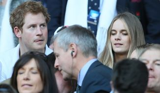 FILE - A Sunday, March 9, 2014 photo from files showing Britain's Prince Harry, top left, with his girlfriend Cressida Bonas, top right,  as they attend the Six Nations Rugby Union match between England and Wales at Twickenham stadium in London. British news media are reporting that Prince Harry and his girlfriend Cressida Bonas have split up. Press Association cited an unidentified source as saying that Harry, 29, and Bonas, 25, had decided to end their two-year relationship. Other news media _ including the BBC, the Daily Mail and The Sun _ also reported the breakup, giving no sources. Royal officials declined to comment.(AP Photo/Alastair Grant, File)