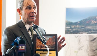 Provo Mayor John Curtis speaks during a press conference at the Zions Bank building in Provo on Tuesday, April 29, 2014. Mayor Curtis announced that the city will be purchasing 80 acres of land in Rock Canyon, ending a multi-decade land dispute and ensuring the preservation of the canyon. (AP Photo/The Daily Herald, Spenser Heaps)