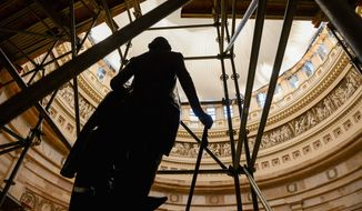 A statue of President George Washington can be seen through scaffolding in the U.S. Capitol Dome Rotunda which is set to reopen to the public after completion of the safety netting installation as the Dome Restoration Project begins at the U.S. Capitol Building, Washington, D.C., Wednesday, April 30, 2014. Five layers of safety netting is being installed to protect against falling debris from the Rotunda during a restoration project on the Dome of the U.S. Capitol Building. (Andrew Harnik/The Washington Times) (andrew harnik/the washington times)
