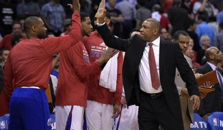 Los Angeles Clippers head coach Doc Rivers, right, congratulates members of his team during the second half in Game 5 of an opening-round NBA basketball playoff series against the Golden State Warriors, Tuesday, April 29, 2014, in Los Angeles. The Clippers won 113-103. (AP Photo)