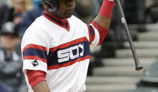 Chicago White Sox's Alejandro De Aza walks back to the dugout after striking out during the ninth inning of a baseball game against the Detroit Tigers in Chicago, Wednesday, April 30, 2014. The Tigers won 5-1. (AP Photo/Nam Y. Huh)