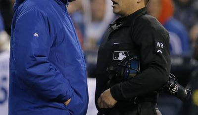 Kansas City Royals manager Ned Yost, left, requests a review of a play at the plate from umpire Mark Wegner, right, during the fourth inning of a baseball game against the Toronto Blue Jays at Kauffman Stadium in Kansas City, Mo., Wednesday, April 30, 2014. (AP Photo/Orlin Wagner)