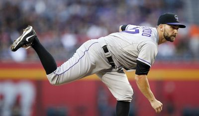 Colorado Rockies' Tyler Chatwood throws a pitch against the Arizona Diamondbacks during the first inning of a baseball game on Tuesday, April 29, 2014, in Phoenix. (AP Photo/Ross D. Franklin)