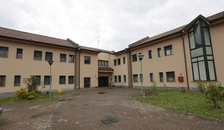 A view of the San Pietro department of the 'Sacra Famiglia foundation', where former Italian Premier Silvio Berlusconi will carry out a court order to help the elderly, in Cesano Boscone, Italy, Wednesday, April 30, 2014. Berlusconi will help patients with Alzheimer disease for four hours per week as part of his punishment for tax fraud conviction. (AP Photo/Luca Bruno)
