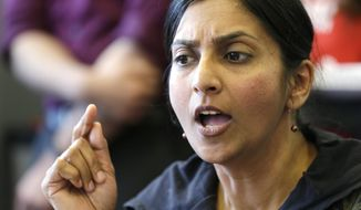 Seattle City Council Member Kshama Sawant addresses a news conference on a proposal to increase the minimum wage in the city, in Seattle, in this April 24, 2014, file photo. (AP Photo/Elaine Thompson, File) ** FILE **