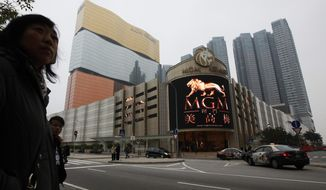 FILE - This Feb. 15, 2011, file photo shows a promotional screen with the Chinese characters for MGM displayed at the MGM Grand Macau casino resort, in Macau. MGM Resorts reports quarterly earnings on Tuesday, April 29, 2014. (AP Photo/Kin Cheung, File)