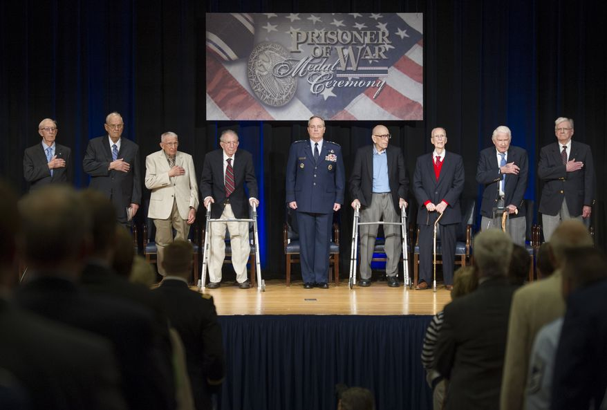 Air Force Chief of Staff Gen. Mark Welsh III, center, stands for the National Anthem, with former Wauvilermoos prison camp Air Force POW's during a ceremony at the Pentagon., Wednesday, April 30, 2014. From left; Tech. Sgt. Alva Moss, Sgt., William Blackburn, 1st Lt., James Mahon, Lt. Col. James Misuraca, Welsh III, Major James Moran, 1st Lt. James Mahon, Staff Sgt. John Fox and Sgt. George Thursby.  (AP Photo/Cliff Owen)
