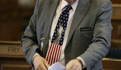 Rep. Dwayne Alons, R-Hull, packs up his desk in the Iowa House, Wednesday, April 30, 2014, at the Statehouse in Des Moines, Iowa. (AP Photo/Charlie Neibergall)