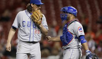 Chicago Cubs starting pitcher Jeff Samardzija (29) talks with catcher Welington Castillo in the sixth inning of a baseball game against the Cincinnati Reds, Tuesday, April 29, 2014, in Cincinnati. (AP Photo)