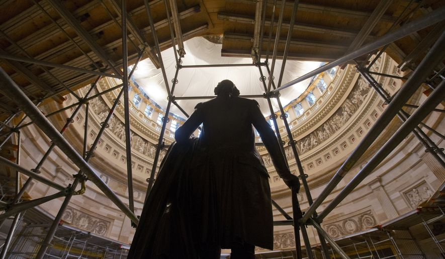 The statue of George Washington is seen surround by scaffolding after safety netting was installed around the inside the Capitol Rotunda, Wednesday, April 30, 2014. Five layers of safety netting where used as part of a $60 million restoration project of the Capitol dome and is the first major renovation since 1960. (AP Photo)