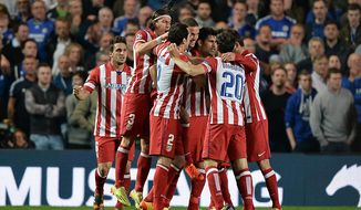 Atletico Madrid's Diego Costa, center right, celebrates with his teammates after scoring his side's second goal during the Champions League semifinal second leg soccer match between Chelsea and Atletico Madrid at Stamford Bridge Stadium in London, Wednesday, April 30, 2014. (AP Photo/Andrew Matthews, PA Wire)    UNITED KINGDOM OUT   -   NO SALES   -  NO ARCHIVES