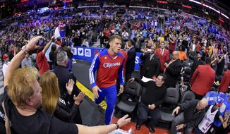 Los Angeles Clippers forward Blake Griffin comes onto the court before Game 5 of the Clippers' opening-round NBA basketball playoff series against the Golden State Warriors on Tuesday, April 29, 2014, in Los Angeles. (AP Photo)