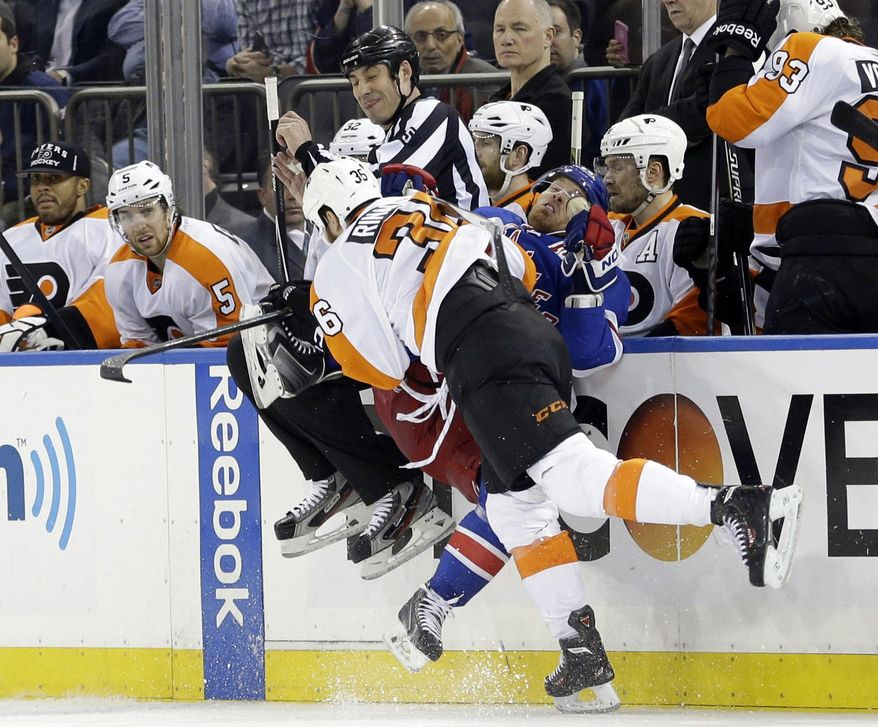 Philadelphia Flyers' Zac Rinaldo (36) checks New York Rangers' Brad Richards (19) during the first period in Game 7 of an NHL hockey first-round playoff series on Wednesday, April 30, 2014, in New York. (AP Photo)