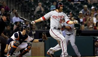 Washington Nationals' Adam LaRoche (25) watches a single that scored Denard Span during the ninth inning of a baseball game, in front of Houston Astros catcher Jason Castro on Tuesday, April 29, 2014, in Houston. (AP Photo/David J. Phillip)