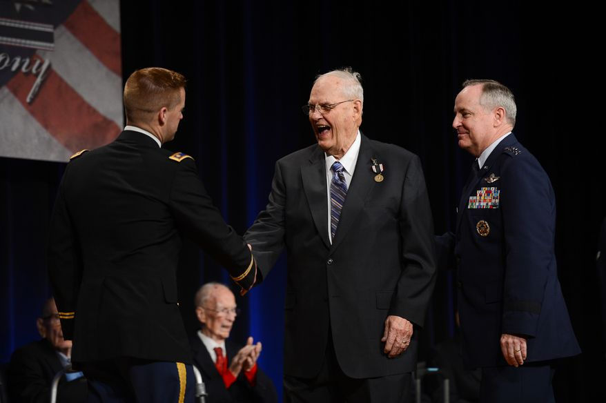 Army Major Dr. Dwight Mears, left, and Air Force Chief of Staff Gen. Mark A. Welsh III, right, present the Prisoner of War Medal to Sgt. William G. Blackburn, center, and seven other Former Wauvilermoos prison camp POW World War II era U.S. Army Air Forces personnel during a ceremony at the Pentagon, Arlington, Va., Wednesday, April 30, 2014. (Andrew Harnik/The Washington Times)