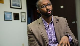 ADVANCED FOR RELEASE MONDAY, MAY 5, 2014 Jaylani Hussein, board member of the American Relief Agency for the Horn of Africa, speaks about the history of Somalia on Saturday, April 26, 2014. (AP Photo/Minnesota Daily, Alicia McCann)