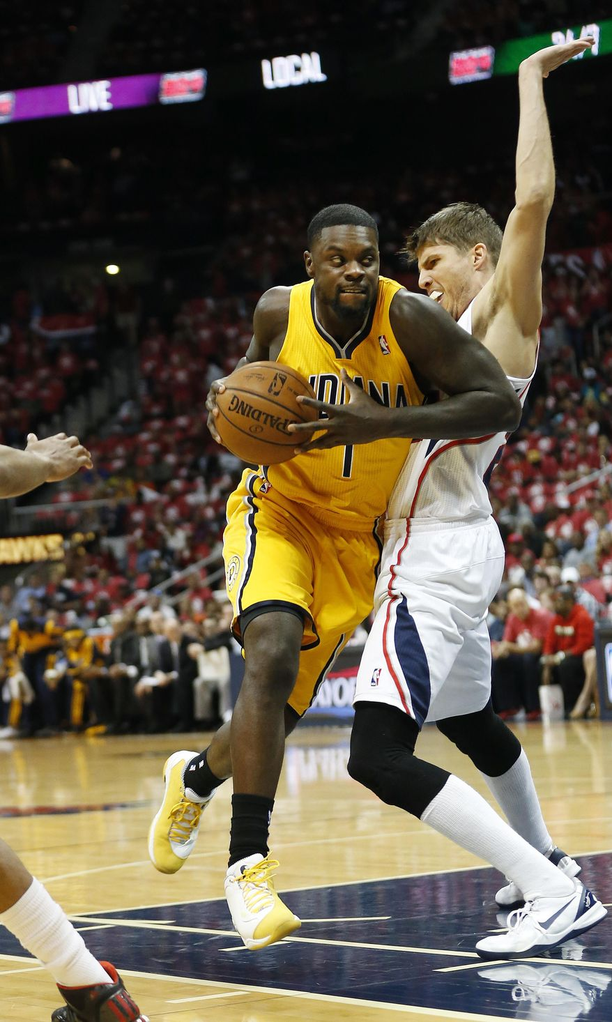 Indiana Pacers guard Lance Stephenson (1) drives against Atlanta Hawks guard Kyle Korver (26) in the first half of Game 6 of a first-round NBA basketball playoff series in Atlanta, Thursday, May 1, 2014. (AP Photo/John Bazemore)