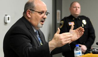 Waseca school superintendent Thomas Lee gestures during  a press conference Thursday, May 1, 2014. Police arrested a 17-year-old suspect Tuesday and charged him in juvenile court Thursday, with four counts of attempted first-degree murder, six counts of possessing explosive or incendiary devices and two counts of criminal damage to property. (AP Photo/The Mankato Free Press, John Cross)