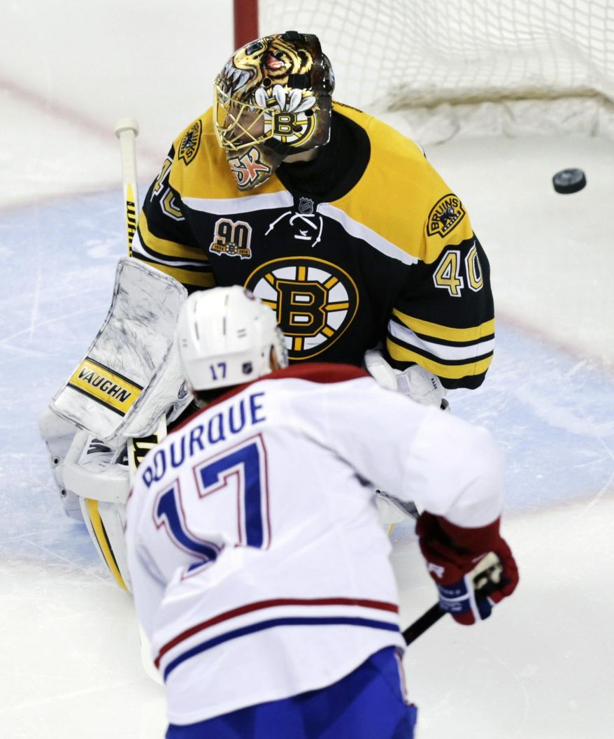Boston Bruins goalie Tuukka Rask (40) misses a shot by Montreal Canadiens left wing Rene Bourque (17) during the second period of Game 1 in the second-round of a Stanley Cup playoff series in Boston, Thursday, May 1, 2014. (AP Photo/Charles Krupa)