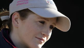 Jockey Rosie Napravnik answers questions at Churchill Downs Thursday, May 1, 2014, in Louisville, Ky. (AP Photo/Garry Jones)