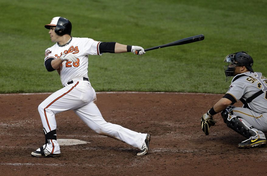 Baltimore Orioles' Steve Pearce, left, drives in teammate Steve Clevenger on an RBI-single in the sixth inning of the first baseball game of a doubleheader against the Pittsburgh Pirates, Thursday, May 1, 2014, in Baltimore. (AP Photo/Patrick Semansky)