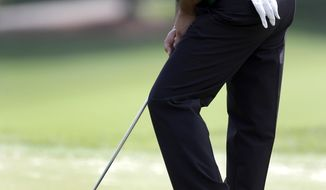 Angel Cabrera, of Argentina, reacts as he misses a putt on the 15th hole during the first round of the Wells Fargo Championship golf tournament in Charlotte, N.C., Thursday, May 1, 2014. (AP Photo/Bob Leverone)