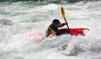 Michael Penwell of Corvallis, Ore., paddles in the water below Bullseye rapid on the North Fork of the Middle Fork Willamette River, near Westfir, Ore., on Sunday, April 13, 2014. (AP Photo/Zach Urness / Statesman Journal)