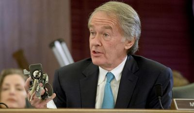 ** FILE ** Sen. Edward Markey, D-Mass. holds up a GM ignition switch while questioning General Motors CEO Mary Barra on Capitol Hill in Washington, Wednesday, April 2, 2014, during a Senate Commerce, Science and Transportation subcommittee hearing. (AP Photo/Pablo Martinez Monsivais)